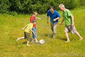 happy-family-playing-soccer-15183514